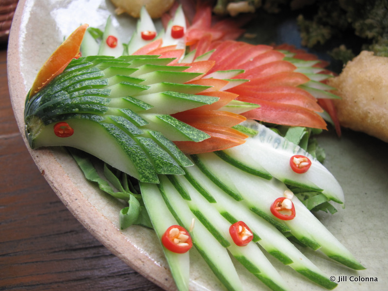 Thai vegetable decorations using cucumbers and tomato