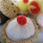 knitted tartlet with pom-pom cherry