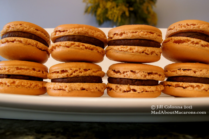 4 stacks of 2 caramel chocolate macarons