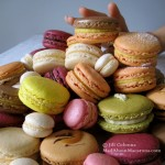 greedy stack of colourful Parisian macarons