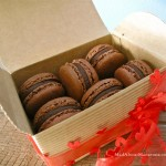 chocolate macarons in treasure paper box