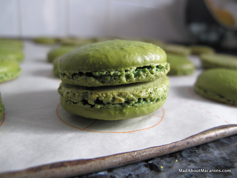 pairing green macaron shells before filling