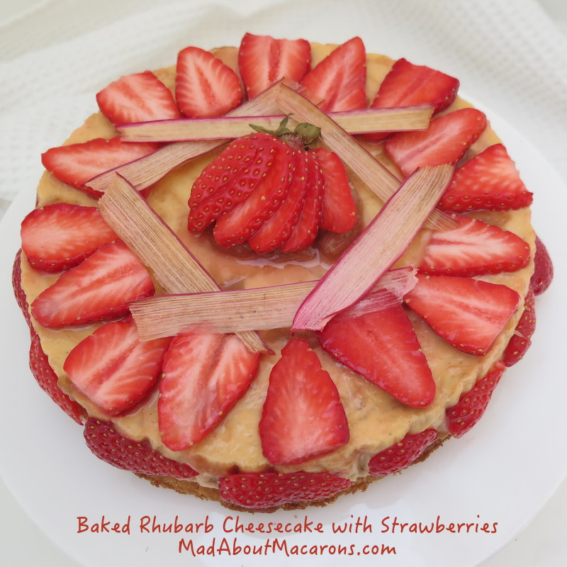 Baked rhubarb and custard cheesecake with strawberries
