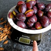 plum jam weighing sugar with digital scales